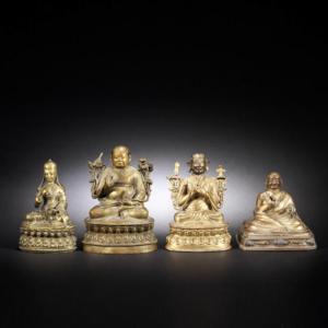cuatro figuras de bronce dorado de lamas